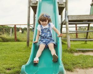 Bluebells Play Park - Girl Playing on the slide