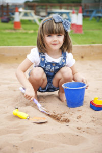 Bluebells Play Park - Girl playing in sandpit
