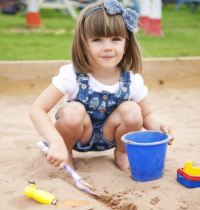 Bluebells Play Park - Girl Playing in the sandpit
